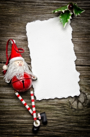 Greeting card for Christmas with Santa Claus decoration and holly