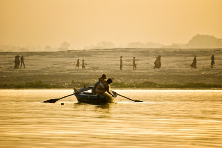 ganges: VARANASI, INDIA - APRIL 24: fishermen pullining a nets in Varanasi, India on 24 april 2010. Fishermen work start very early in the mornig before sunrise