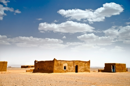 mud house: mud houses in a desolated landscape, Sahara desert, Morocco