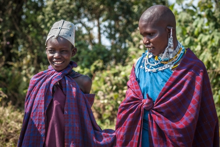 LAKE EMPAKAI, TANZANIA-AUG 15: portrait of Masai woman and child near lake Empakai, Tanzania, on aug 15, 2010. Maasai (Masai) are a Nilotic ethnic group of semi-nomadic people located in Kenya and northern Tanzania