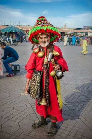 Marrakech, Morocco-26, mar: water peddler in the Djemaa El Fna on 26, mar, 2013, in Marrakech, Morocco. The square is part of the UNESCO World Heritage. Editorial