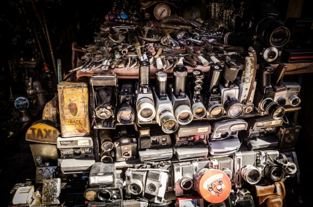 suq: Marrakech, Morocco - March 19, 2013: Old cameras sold in a market in Marrakech. Analog cameras are easy to find in the Suq, but they usually don Editorial