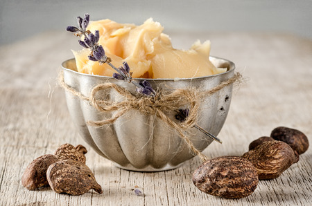Cup of shea butter with shea nuts