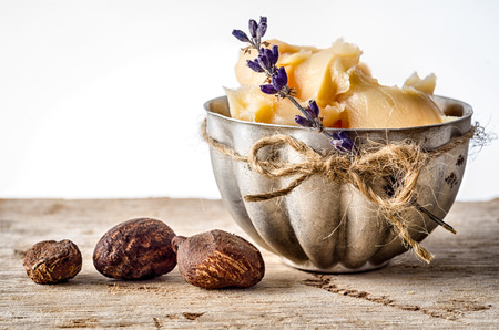 Cup of shea butter with shea nuts photo