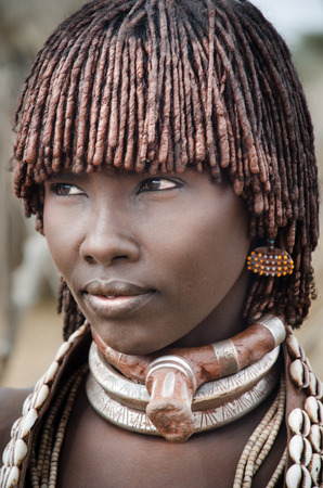 TURMI, ETHIOPIA - 12 AUGUST  portrait of unidentified Hamer tribe woman, Omo valley, 12 august 2014  Hamer woman usualy comb their hairs with soil