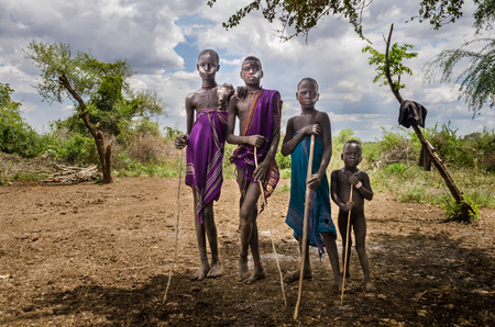 JINKA, ETHIOPIA - AUGUST 10: portrait of unidentified Mursi men on August 10 2014. Mursi people wear many ornament and paint their bodies Editorial