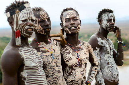 Kolcho, Ethiopia - August, 12: Unidentified Karo boys near the village of Kolcho, Ethiopia on August 12,2014. Karo tribe people are famouse for their body painting
