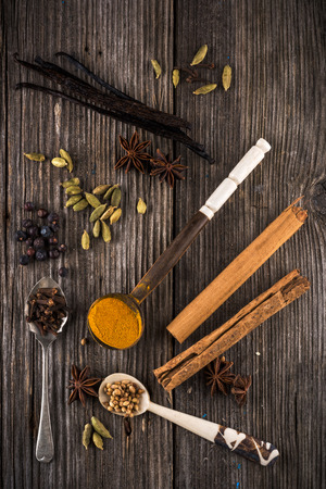 Mixed spices on a wooden table