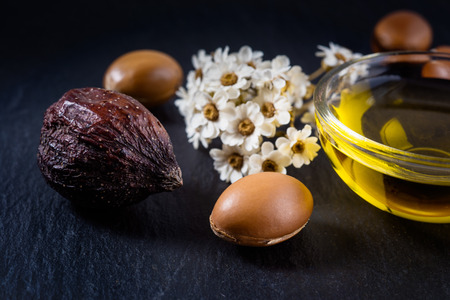 Argan oil and fruits Stock Photo