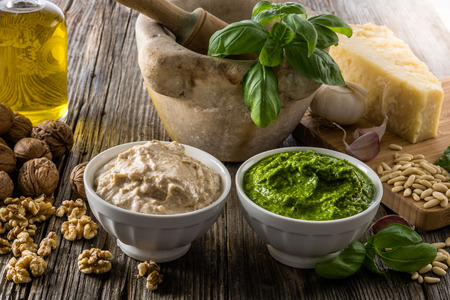 mediterraneo: Two cups full of Pesto and nuts sauce, tipical ligurian Italy souces for pasta