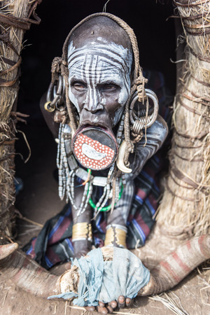 body painting: JINKA, ETHIOPIA, - 19 AUGUST 2015:unidentified women from Mursi tribe with big lip Plate, in Mago National Park,. The more the lip plate is big, the more the woman is considered beautiful