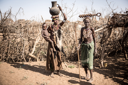 africa child: Omorate, ETHIOPIA - AUGUST 17 2015: Unidentified women from Deesenach tribe. Tribes of the Omo Region are endangered Because of the governament politics wich is stealing Their territory Editorial