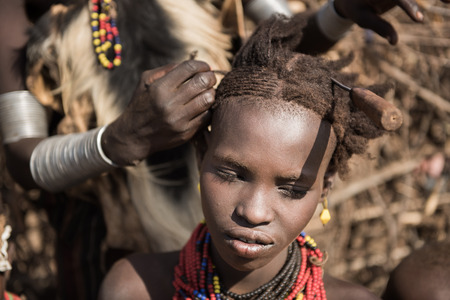 tribes: OMORATE, ETHIOPIA - 17 AUGUST 2015: Unidentified women from Deesenach tribe. Tribes of the Omo Region are endangered because of the governament politics wich is stealing their territory Editorial