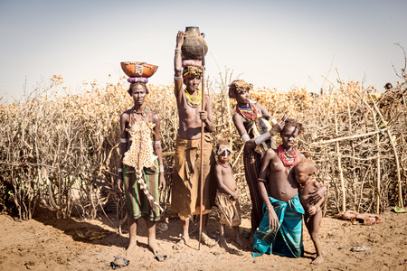 OMORATE, ETHIOPIA - 17 AUGUST 2015: Unidentified women from Deesenach tribe. Tribes of the Omo Region are endangered because of the governament politics wich is stealing their territory Editorial