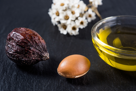argan: Argan oil and fruits Stock Photo