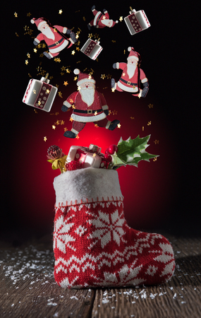 Christmas decoration flying on a black background with explosion of star glitter Stock Photo