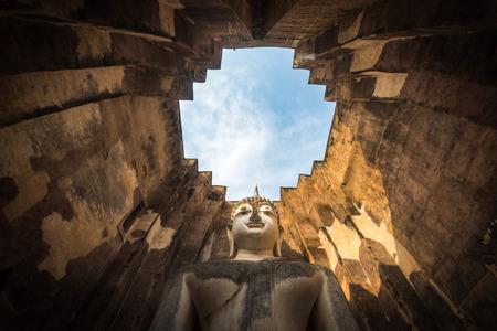 chum: Sukhothai historical Park, Thailand, the giant statue of Buddha in the Wat Si Chum