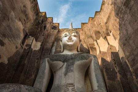 chum: Sukhothai historical Park, Thailand, the giant statue of Buddha in the Wat Si Chum