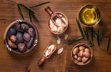 Composition of argan fruits, seeds, oil, cream and soap fot skin care Foto de archivo