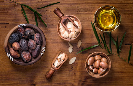 Composition of argan fruits, seeds, oil, cream and soap fot skin care Standard-Bild