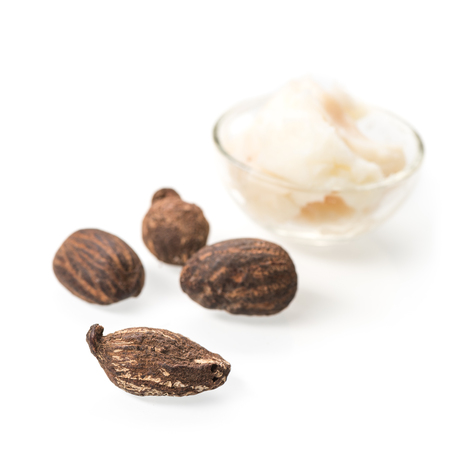 shea butter: Shea butter and nuts on white Stock Photo