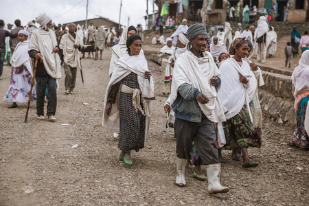 weekly market: SIMIEN MOUNTAINS, ETHIOPIA - AUGUST 29,2015: crowded weekly market in a small village in Ethiopia. In these markets are sold of kind of goods and animals