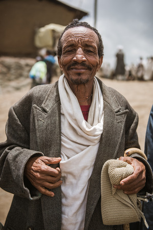 cristian: SIMIEN MOUNTAINS, ETHIOPIA - AUGUST 29,2015: Portrait of an unidentified  man in a crowded weekly market in a small village in Ethiopia. In these markets are sold of kind of goods and animals Editorial