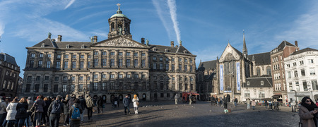 make known: AMSTERDAM, THE NETHERLANDS - 20 JANUARY, 2017: The Dam Square in the center of the town. Its notable buildings and frequent events make it one of the most well-known and important locations in the city and the country. Editorial
