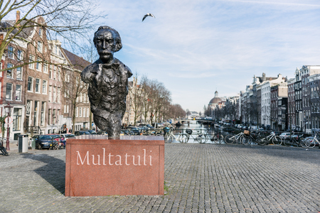 abuses: AMSTERDAM, THE NETHERLANDS - JANUARY 20, 2017:  the statue dedicated to Multauli, the pen name of Eduard Douwes Dekker. He was a Dutch writer famous for his satirical novel Max Havelaar, which denounced the abuses of colonialism