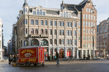notable: AMSTERDAM, THE NETHERLANDS - 20 JANUARY, 2017: The Dam Square in the center of the town. Its notable buildings and frequent events make it one of the most well-known and important locations in the city and the country. Editorial