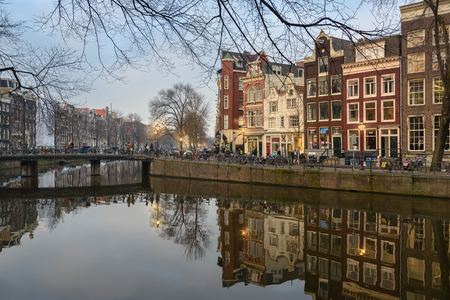 AMSTERDAM, THE NETHERLANDS - JANUARY 20, 2017:  Amsterdam, has more than one hundred kilometers of canals, about 90 islands and 1,500 bridges. The three main canals, Herengracht, Prinsengracht, and Keizersgracht