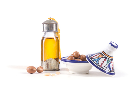 Argan oil and fruits, used  for skin care and hair on a white background.