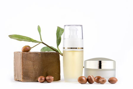 Cosmetic products and soap with argan fruits for skin care and hair on a white background. Space for labels and graphics Stock Photo