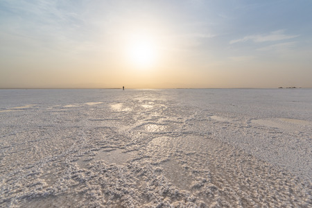 The salty surface of Ass Ale Lake in the Danakil depression, Ethiopia, one of the hottest plase in the world