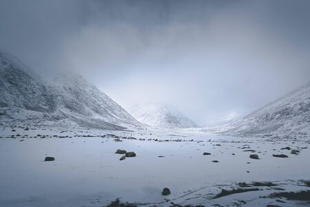 Himalayan winter landscape in Ladakh, India, during a snowy day Stock Photo