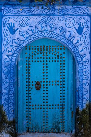 Richly decorated blue door