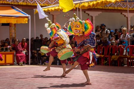MBuddhist monks with traditional masks performing ritual dances