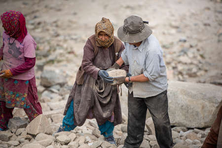 Men and women at work, in Ladakh Stock Photo