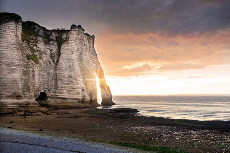 Famous cliffs of Etretat, france, at sunset