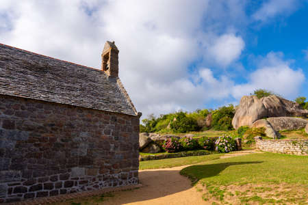 Little stone church of Ploumanach in Perros Guirec. Pink granite coast, Perros Guirec, Brittany, France. Stock Photo