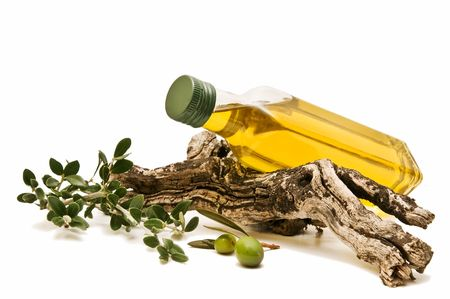 bottle of olive oil with olive branches lying