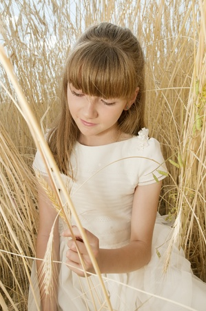 girl wearing first communion dress among the spikes Stock Photo - 10082259