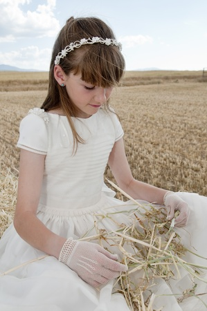 girl wearing first communion dress photo