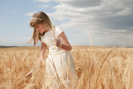 girl wearing first communion dress among the spikes Stock Photo - 10082246