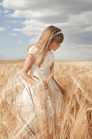 girl wearing first communion dress among the spikes Stock Photo - 10082252