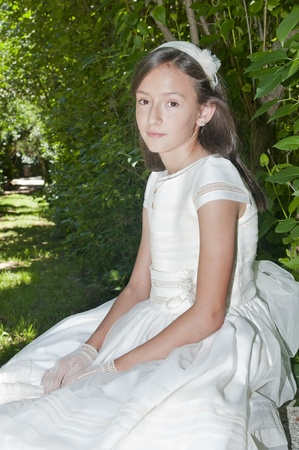 girl white dress the day of their first communion