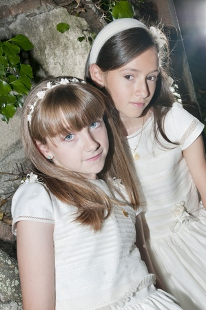 girls white dress the day of their first communion Stock Photo - 10976150