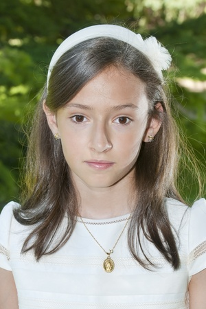 christian confirmation: girl white dress the day of their first communion