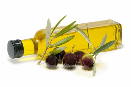 green bottle: bottle of olive oil and fresh olives on white background