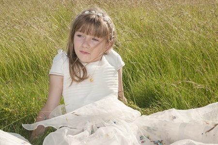 girl communion in the meadow photo